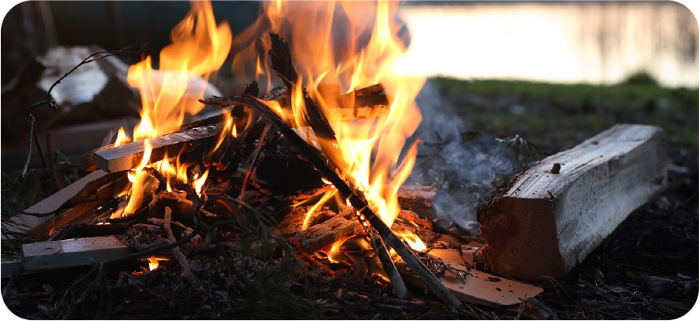 a campfire burns outside the M&M Hunting Lodge in Pennsvile, NJ